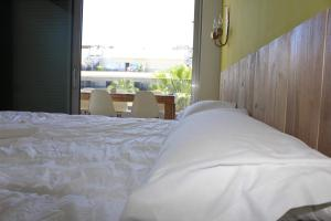 A bed or beds in a room at Royal Beach Luxury Apartments