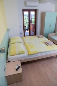 A bed or beds in a room at Zoi Apartments