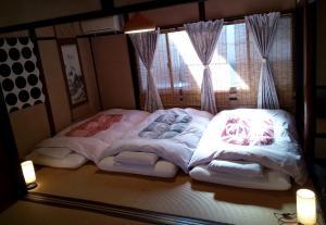 A bed or beds in a room at Kyoto Villa Chiyotsuru