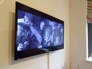 A television and/or entertainment center at Lux Apartment