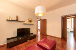 A television and/or entertainment center at Heart Milan Apartments Corso Como