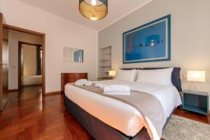 A bed or beds in a room at Heart Milan Apartments Corso Como