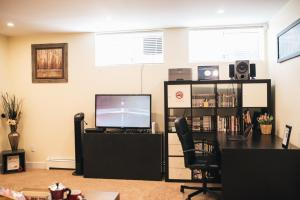 A television and/or entertainment center at Spacious and Luxury suite near Downtown Vancouver