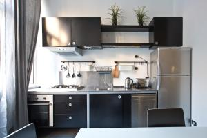 A kitchen or kitchenette at RSH Trevi Fountain Apartments