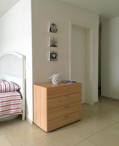 A bed or beds in a room at Charming Studio near Rotsee Lucerne Kitchen/WiFi/Wasching machine