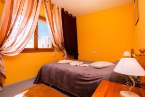 Łóżko lub łóżka w pokoju w obiekcie Espanatour Polska