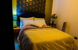 Cama o camas de una habitación en Boutique Amaru Wasi