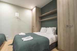 A bed or beds in a room at Dreamyflat - Haut marais