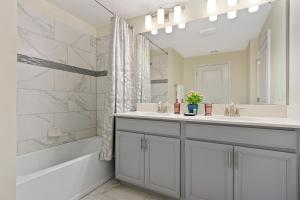 A bathroom at Four Bedrooms close to Disney w Pool 4898