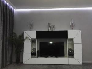 A television and/or entertainment centre at Apartment Villa Ksenija