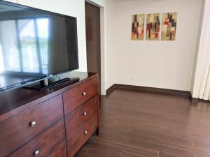 A television and/or entertainment center at Oceanview Hotel and Residences