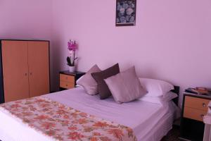 A bed or beds in a room at Albergo Residence Pucara