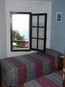 A bed or beds in a room at Villa Searenity