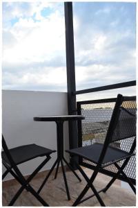 Un balcón o terraza de Apartamentos del Centro