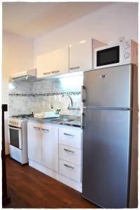Una cocina o zona de cocina en Apartamentos del Centro