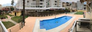 A view of the pool at Apartamentos Las Palomas Beach or nearby