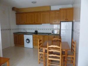 Una cocina o zona de cocina en Villa Madrid