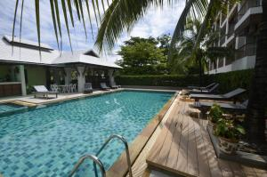 The swimming pool at or near Sakorn Residence and Hotel