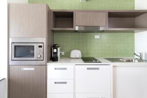 A kitchen or kitchenette at Abode Gungahlin