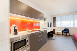 A kitchen or kitchenette at Abode Woden