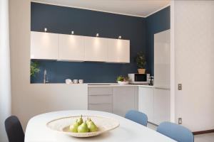 A kitchen or kitchenette at HomeatHotel - Niguarda Ossola Apt