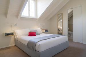 Un ou plusieurs lits dans un hébergement de l'établissement Brera Apartments in Garibaldi