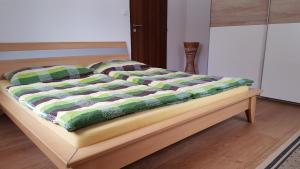 Postel nebo postele na pokoji v ubytování Apartmány Lipno-1