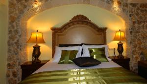 A bed or beds in a room at Arhontopetra Suites & Spa