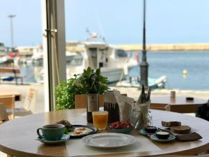 A restaurant or other place to eat at Nival Luxury Suites