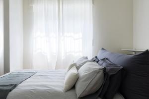 Letto o letti in una camera di The Photographer Loft