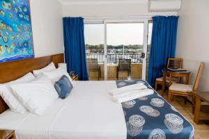 A bed or beds in a room at Cullen Bay Resorts