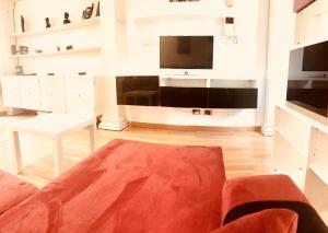 A seating area at Giulio Cesare luxury apartment