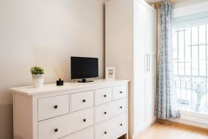 A television and/or entertainment center at Nice apartment near Barcelona center