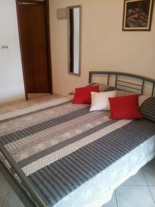 A bed or beds in a room at Apartments Ileana