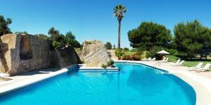 The swimming pool at or near Casal Santa Eulalia