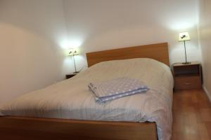 A bed or beds in a room at Escapade alsacienne