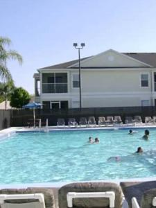 The swimming pool at or near Grand palm 8840b