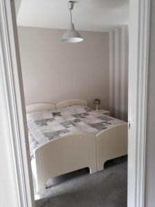 A bed or beds in a room at Festina Lente