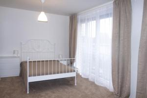 A bed or beds in a room at Apartment for 4 people in Prague