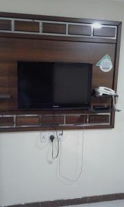 A television and/or entertainment center at Qimam Saba Furnished Units (for families only)