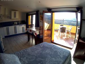 Cama o camas de una habitación en Apartamentos Turisticos Mirayuste