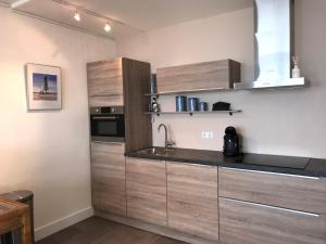 A kitchen or kitchenette at Panoramic Beach Apartment