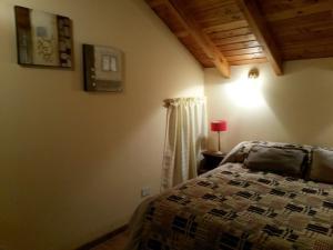 Una cama o camas en una habitación de Vista Panorámica