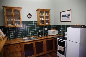 A kitchen or kitchenette at Burra Railway Station Bed and Breakfast