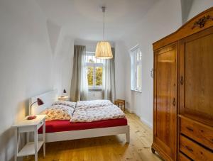 Ein Bett oder Betten in einem Zimmer der Unterkunft Ferienwohnung Eschebach