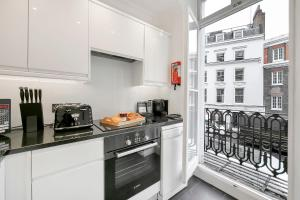 A kitchen or kitchenette at 10 Curzon Street by Mansley