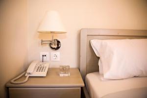 Ένα ή περισσότερα κρεβάτια σε δωμάτιο στο Ellanion Studios