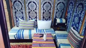 A bed or beds in a room at Casa Meryem