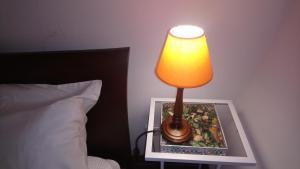 Postel nebo postele na pokoji v ubytování Bella 's House 3