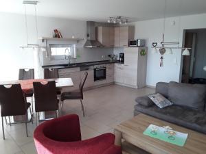 A kitchen or kitchenette at Haus am Leuchtfeuer